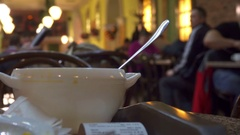 Bowl of soup close-up in a self-service restaurant, blurred background Stock Footage