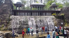 Many Indian tourists, large waterfall, Rock Garden of Chandigarh, India Stock Footage