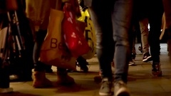 People walk down london oxford street shopping at night with sound Stock Footage