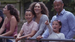 4K Happy family at the zoo looking into animal enclosure. Stock Footage