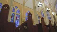 Church pews in beautiful old Catholic church Stock Footage