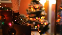 Dancing feet on glowing staircase on the background of the Christmas tree. Stock Footage