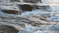Flowing water of a rough river and rocks Stock Footage