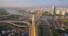 Aerial Approach Shot of Bangkok Cityscape and Bhumibol Bridge Stock Footage
