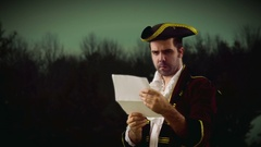 Colonial man reading decree writting letter Stock Footage