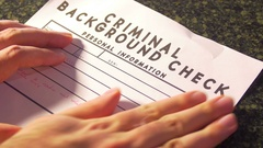 Criminal background check paperwork Stock Footage