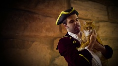 Colonial man with cat kitty historical Stock Footage