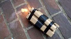 Dynamite TNT fuse fuze lit explosive bomb Arkistovideo