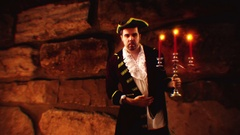 Historical colonial man in dark area dungeon Stock Footage