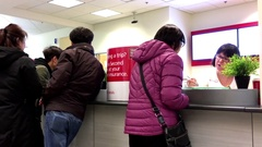 People talking to the teller inside Scotiabank with 4k resolution Stock Footage