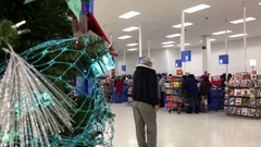One side of check out counter beside Christmas tree inside Walmart store Stock Footage