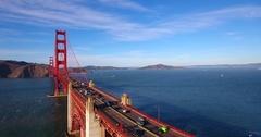 Aerial Rising Over Golden Gate Bridge Cars Driving Across 4K Stock Footage