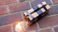Dynamite TNT fuse fuze lit explosive bomb 2 Stock Footage