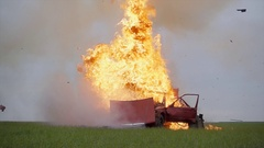 Car fire on desert rural road Stock Footage