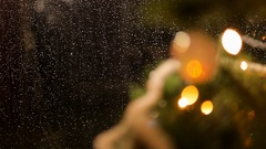 Drops of rain on New Year window glass on the background of the Christmas toys. Stock Footage