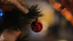 Toys on the Christmas tree in the background of a wet window. Illuminations. Stock Footage