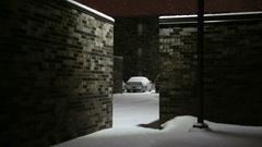 Snowing Between Buildings Stock Footage