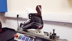 Moscow, Russia - December 08.2016. Sharpening skates Bauer on ProSharp machine Stock Footage