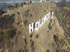 Aerial moving around Hollywood sign big letters famous hills Los Angeles CA 4K Stock Footage