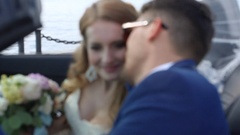 A young happy couple, the gentle embrace in the black convertible car. Stock Footage
