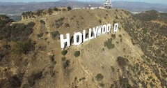 Aerial moving toward and over Hollywood sign huge letters on hills LA 4K Stock Footage
