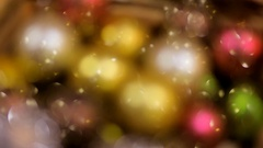Many multicolored sparkling Christmas tree decorations in box. Stock Footage