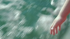 Child pulling hand down from sailing boat Stock Footage