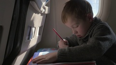 Close up view of small boy learning to writing with pencil Stock Footage