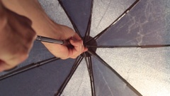 Closing umbrella after the rain Stock Footage