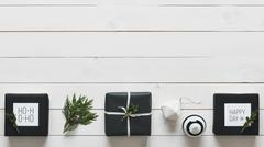 Elegant nordic retro christmas presents, desk view from above, DIY xma Stock Photos