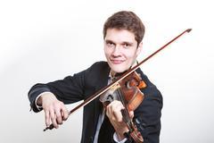 Man man dressed elegantly playing violin Stock Photos