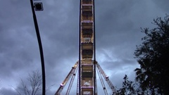 Lateral view of a big wheel at dusk Stock Footage