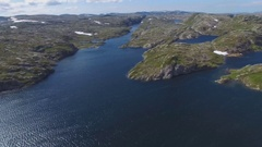 Flying over the rocky coast of Norway Stock Footage