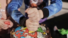 The hands of children, decorating a cake Stock Footage