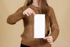 Girl showing blank white flyer brochure booklet. Leaflet presentation. Pamp.. Stock Photos