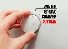 Male hand turns the switch. Switches seasons. Chose the autumn. Stock Photos