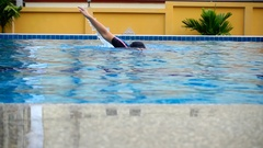 View front of woman swimmer swimming the crawl in pool, Slow motion shot Stock Footage