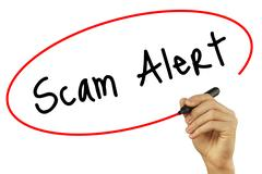 Man Hand writing Scam Alert with black marker on visual screen. Isolated on.. Stock Photos