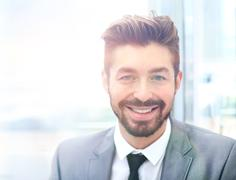 Portrait of happy smiling business man, isolated on white background Stock Photos