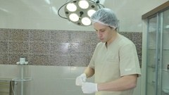 Male surgeon holding syringe with vaccine Arkistovideo