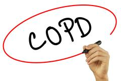 Man Hand writing COPD with black marker on visual screen. Isolated on backg.. Stock Photos