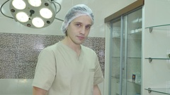 Male surgeon holding syringe with vaccine Stock Footage