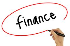 Man Hand writing Finance with black marker on visual screen. Isolated on ba.. Stock Photos