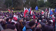WARSAW, POLAND - DECEMBER, 17, 2016. People with Polish and EU flags chanting Stock Footage