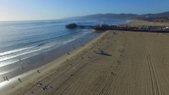 Aerial of Santa Monica Pier and beach sand panning to houses and community Stock Footage