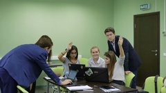 Group of students complete practical exercises on the lesson on economics Stock Footage
