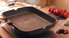 Curving a barbecued meat on a wooden chopping board ad putting it on a tray Stock Footage