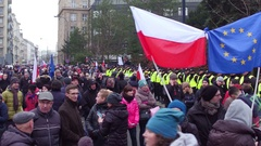 WARSAW, POLAND - DECEMBER, 17, 2016. People with tied Polish and EU flags in the Stock Footage