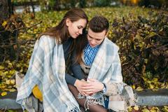 Young couple at the park in autumn season Stock Photos