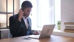 Black Businessman Attending Customer Call, Call Center Stock Footage